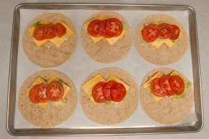 2 ounces of turkey, 1 ounce of cheese (two ½ ounce slices), ¼ cup of  lettuce and tomato slice on each tortilla